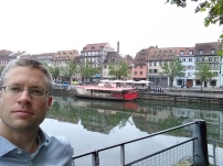 William in front of the River Ill that surrounds Strasbourg's core.
